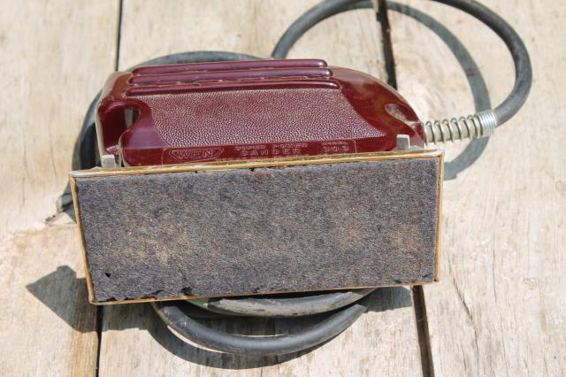 vintage electric palm sander, 1950s red bakelite woodworking power tool