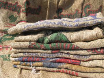 vintage farm primitive burlap potato bags w/ bright advertising graphics, 50 lb sacks