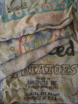 vintage farm primitive burlap potato bags w/ bright advertising graphics
