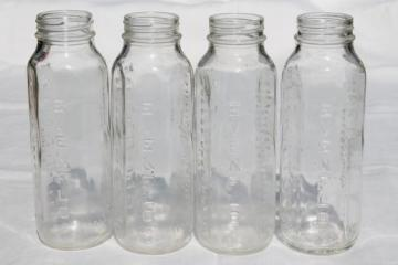 vintage glass baby bottles, lot of four 8 oz Evenflo nursing bottles