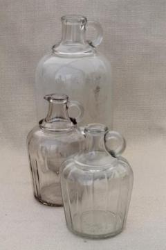 vintage glass bottles, lot of old glass syrup jugs large & small