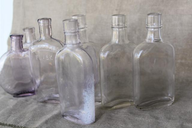 vintage glass bottles w/ old sun purple color, antique flasks pocket liquor bottle lot