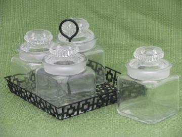 vintage glass canisters or pickle jars in 1950s mod metal carrier rack