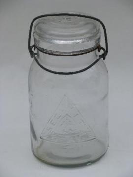vintage glass lightening lid Security Seal mason canning jar, embossed logo