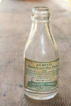 vintage glass medicine bottle w/ old paper label Alder St pharmacy Portland Oregon