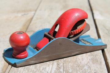vintage hand block plane, old woodworking tool shave wood planer w/ red & blue paint