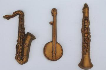 vintage jazz band musical instrument wall plaques, chalkware sax, clarinet, banjo