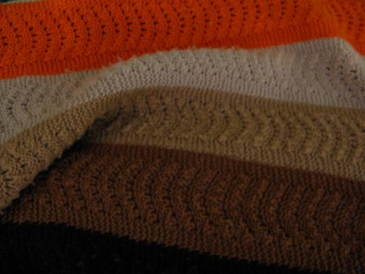 vintage knitted wool blanket, soft and cozy stripes in brown and orange