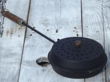 vintage long handled popcorn popper for campfire, fire pit or fireplace