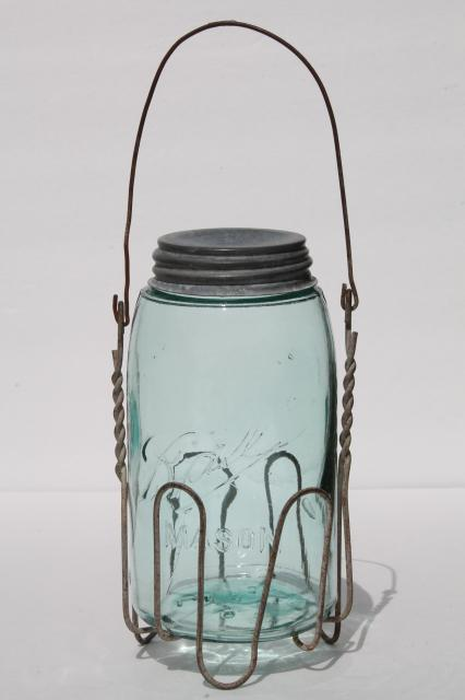 vintage mason jar carrier rack, wire handle basket holds old blue glass jar