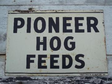 vintage metal sign Pioneer Hog Feed, old farm feed mill advertising