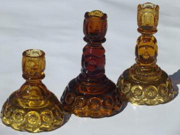 vintage moon & stars pattern glass candlesticks, light & dark amber glass