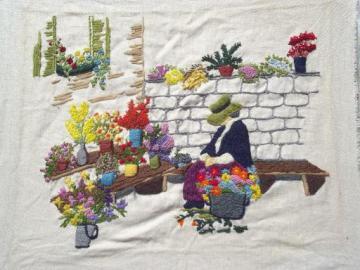 vintage needlework picture, flower peddler lady, embroidered wool on linen