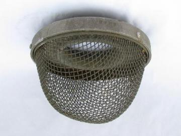 vintage old protective wire cage, industrial lighting