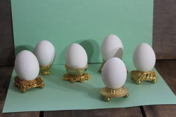 vintage ornamental egg stands, six ornate gold tone metal egg holders