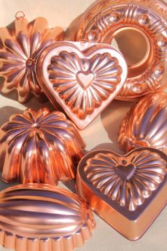 vintage pink aluminum copper jello molds, decorative wall hangers kitchen food mold collection