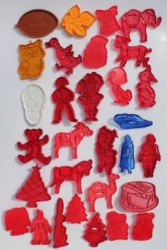 vintage plastic cookie cutter stampers, lot of cookie cutters w/ Robin Hood characters etc.