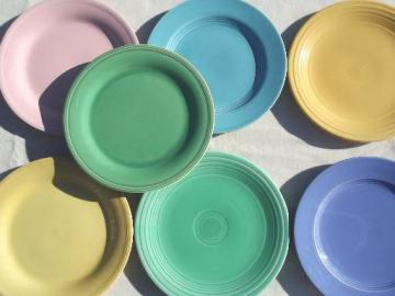 vintage pottery plates in pretty pastels, shabby cottage kitchen dishes