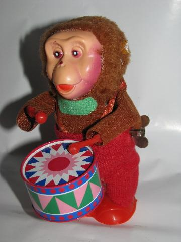 vintage reproduction tin toys, wind-up monkeys musical band