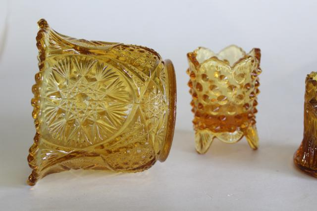 vintage reproductions of antique glass whimsies, amber glass spooner and toothpick holders