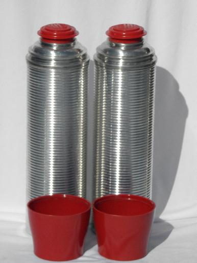 vintage ribbed aluminum thermos vacuum bottles for picnics, tailgating