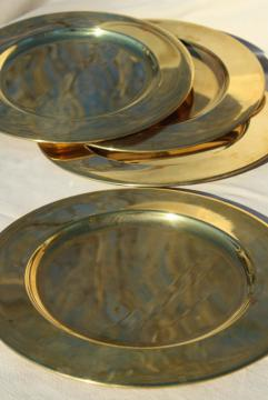 vintage set of four gold charger plates, very heavy solid brass chargers