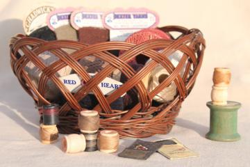 vintage sewing basket, paper cards of mending yarn, spools of darning cotton thread