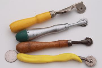 vintage sewing tools, collection of old pattern tracing wheels or pounce wheels