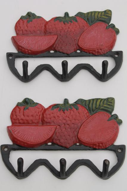 vintage style new cast iron wall mount hooks, red painted strawberries for a country kitchen