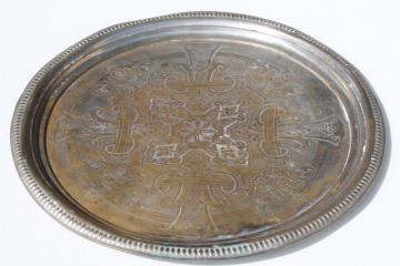 vintage tray or round serving plate, worn antique tin silver wash over solid brass