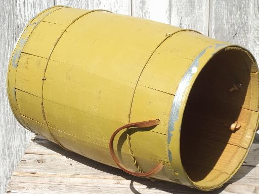 vintage  wood barrel, wooden nail keg in primitive old mustard paint