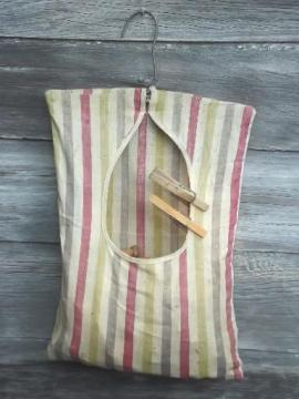 vintage wood clothespins in old cotton clothespin bag for laundry room or wash line