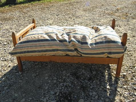 vintage wooden doll bed w/ old red & blue striped ticking feather bed pillow
