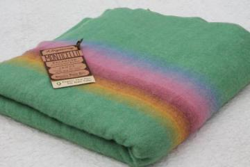vintage wool blanket w/ original label Monticello Wisconsin, candy colored stripes on jade green