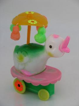 wind-up vintage Easter duck toy, merry-go-round parasol flower cart