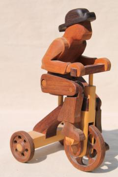working tricycle wooden toy, handmade wood folk art whimsy, man on wheels
